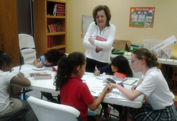 Volunteers tutor 3rd grade girls for their STAAR tests